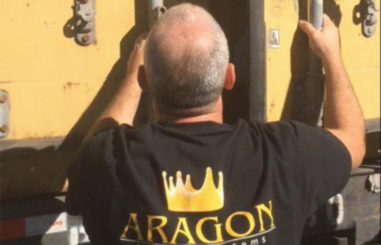 Aragon Moving Systems employee opening truck door
